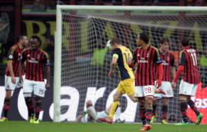 AC Milan's players react after Atletico Madrid scored during the Champions league football match AC Milan vs Atletico Madrid at the San Siro Stadium in Milan on February 19, 2014. AFP PHOTO/ Filippo MONTEFORTE (Photo credit should read FILIPPO MONTEFORTE/AFP/Getty Images)