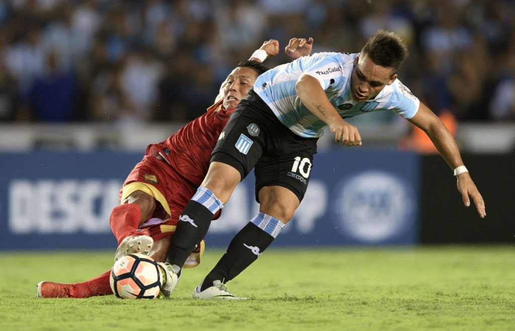 Argentina's Racing Club forward Lautaro Martinez (R) vies for the ball with Colombia's Rionegro Aguilas midfielder John Restrepo during their Copa Sudamericana football match at Juan Domingo Peron stadium in Avellaneda, Buenos Aires, Argentina, on March 1, 2017. / AFP PHOTO / JUAN MABROMATA (Photo credit should read JUAN MABROMATA/AFP/Getty Images)